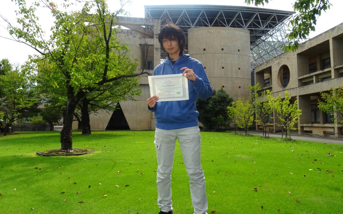 国際高専5年の袖山柾人さんが日本実験力学会主催の国際シンポジウム、ポスター展示発表の部で「Casio Challenge Prize」(最高賞)を受賞しました。